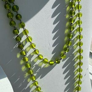 Long strand of green beads